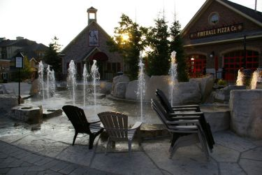 School House and Firehall restaurants: View of 2 restaurants housed in the School House and Firehall within the village square - with water feature in front, all steps from the Grand Georgian Hotel.