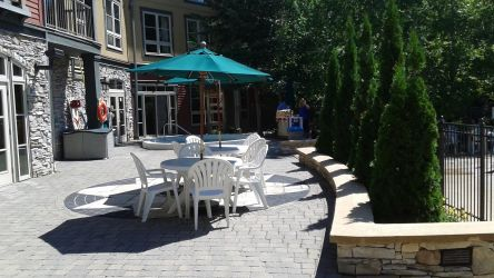 Patio chairs and tables are provided in the pool area during the summer months,